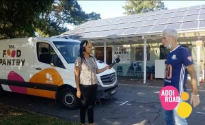Kween G interviewing Craig Foster outside of the Addi Road Food Pantry